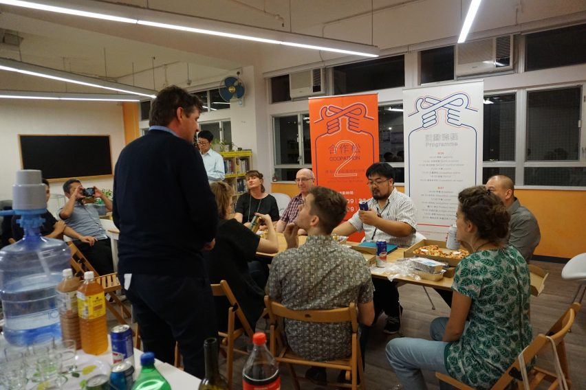 Trebor talking to a small group of people at the Platform Cooperativism Consortium's 2018 conference in Hong Kong.
